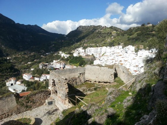 Casares lies nestled against the mountaintop in this photo taken from the castle ruins above.