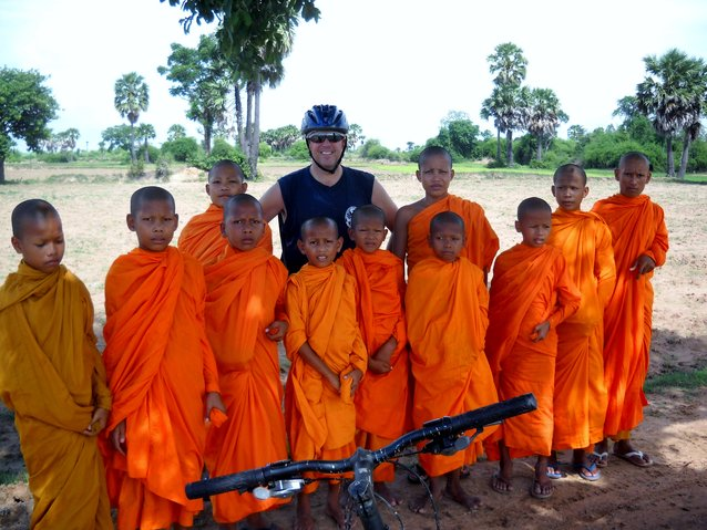 Yours truly with a bunch of young monks during a bike ride outside of Phnom Penh a couple of years ago.