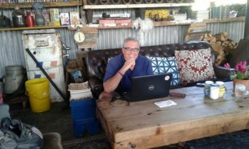 A typical pose for the purveyor of prose, this time in The Blue Shed coffee shop, Mosselbai, South Africa